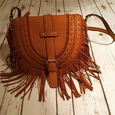 """Cross Body Fringe Bag Gorgeous Adjustable Strap Cross Body Fringe Bag!! Zipper closure with a flap snap. Perfect shade, Camel color that will go with all of your outfits!! Detailed stitching on the front, zipper pocket \ with 2 open pockets inside. 12' by 9"""" and the strap is 48"""" Expressions NYC  Bags Crossbody Bags"""
