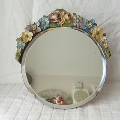 how to decorate your mirror with flowers. i'm thinking this