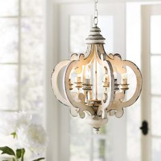 Add charm to your space with this beautifully designed chandelier in a distressed white finish. With an aesthetic look, this exquisite chandelier adds an antique touch to any space. Benzara Antiqued Wood And Metal Chandelier White Wood And Metal Chandelier, Farmhouse Chandelier, White Chandelier, Antique Chandelier, Globe Chandelier, Lantern Pendant, Farmhouse Lighting, Pendant Lights, Farmhouse Decor
