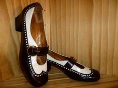 BUCKLE-UP Vintage 1960's Brown and White BUCKLE Wingtip Leather Mod Pump shoes High Heels (Size 7 1/2) by Taicher Cressa made in Spain. $42.00, via Etsy.