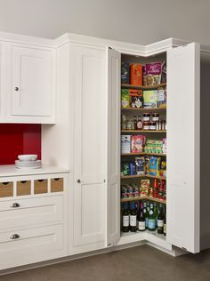 A Harvey Jones corner larder, a great solution for maximising storage space in the kitchen.