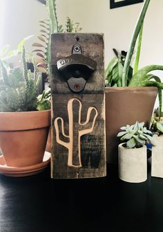 Excited to share the latest addition to my #etsy shop: Bottle opener, Whiskey Barrel bottle opener, Cactus bottle opener, wall mounted bottle opener, recycled barrel wood, gift for him, rustic http://etsy.me/2mTgbnx #housewares #brown #housewarming #christmas  #metal #bottleop