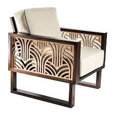Art Deco furnishings. very geometrical patterns on the arms of the chairs.