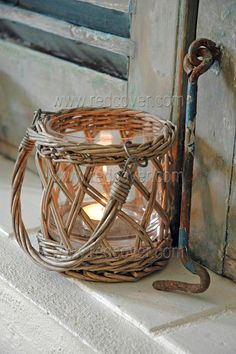 Small basket with votive. I've got these on the fence above the deck!