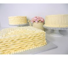 Wedding cake collection in ivory buttercream with coordinating styles | www.cakes4occasions.com | Danvers, MA