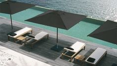 Beautiful lap pool and wooden deck, furniture by Royal Botania _