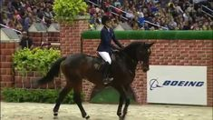 Jessica Springsteen and Lisona Winning the $25,000 Puissance at 2014 WIHS    6' 10""