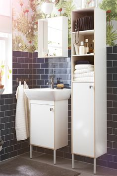 Bathrooms are often the smallest rooms in the home, yet need to have space for everyone's things and activities. The practical and affordable TYNGEN bathroom cabinets are ideal for narrow spaces, while offering plenty of open and closed storage.