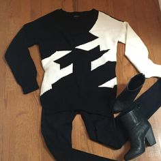 Black & White Oversized V-Neck Sweater Oversized black and white sweater. V neckline. Back is mostly solid black except for the one white sleeve. 65% cotton/35% acrylic. Listing is for the sweater only. Shown with black Rag & Bone skinnies and Newbury boots (neither the jeans nor the boots are for sale by me but multiple sizes/listings available on Posh by other sellers). Cliche Sweaters V-Necks