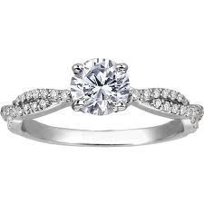 Gorgeous diamonds on the side :) just with a princess cut diamond and it would be perfect :)