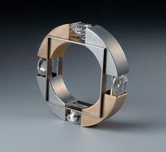 Ring |  Daniel Chiquet Design.  Red-gold, Steel, Titanium and  zirconia