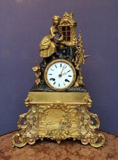 Pendule en bronze patiné et doré, époque Romantique 19ème siècle