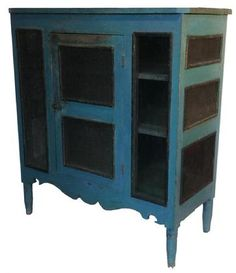 "A475 Mid 19th century Pennslyvania screen Pie safe, with origina robing egg blue paint, single door, very unusual scalloped apron, resting on a simple turned foot, circa 1850 Measurements are:41"" wide x 18"" deep x 46"" tall"