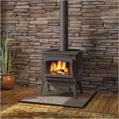 Wood burning stove with stone wall