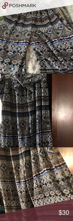 NWOT women's tribal print palazzo pants NWOT Women's tribal print Palazzo pants. Lining is stretchy material in navy, outer material is flowy rayon with tribal patterns in blue, black, white, tan, orange. Wide elastic waist in the back and smooth front with a tie belt. Super comfy, tried on but never worn. Size 3X fits size 20W-22W Magic Pants Wide Leg