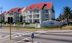 the Courtyard Hotel in Port Elizabeth Low Cost Hotels, Budget Hotels, Port Elizabeth South Africa, Courtyard Hotel, Cruise Port, Cape Town, Traveling By Yourself, Mansions, House Styles