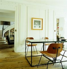 /\ /\ . Frédéric Méchiche . Paris Apartment . Dining Room . Opening onto the library, both spaces have antique bare wooden floorboards.