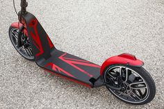 the MINI citysurfer concept is a collapsable urban electric scooter. the MINI citysurfer concept integrates large wheels with pneumatic tires which makes it suitable for bumpy paths. its stable frame and height-adjustable handlebars complements three brake systems which operate independently of each other.