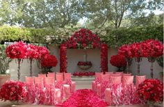 Coral and fuchsia curly willow chair covers Ceremony Ideas: With Asiel Design Photo Courtesy of Grace Ormonde Wedding Style