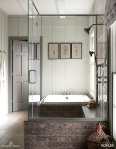 Wet rooms, where the shower and the bath are in the enclosed in the same area, are a growing trend for master #bathrooms. We particularly love how the @Kohler Co. Bancroft #bath was used in the design of this wet room in combination with the Bancroft sing-function showerhead and multifunction handshower.