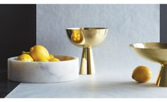 """Elevate a fresh fruit display or centerpiece to new heights with our Brass Pedestal Bowls. These elegant brass bowls will add a sophisticated shine wherever they're used — on the dining table, the buffet or even the kitchen island. They'll also add a sculptural element to a bookshelf or mantle.    •tall: 7.5"""" diameter x 8""""H  •low: 12"""" diameter x 5.5""""H   •polished brass"""
