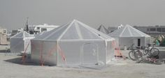 "Building a Hexayurt for BurningMan. A hexayurt is a shelter designed for refugees and other people with a small housing budget. It's also for ""recreational refugees"" like Black Rock City residents, if built with rigid insulation. Burning Man Camps, Burning Man 2015, Camper Trailer Tent, Solar Cooker, Shelter Design, In Case Of Emergency, Just In Case, Burns, Houses"