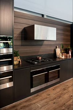 Lush  dark kitchen with timber panelling