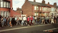 Another image that is so representative of the casuals. UTD away to Everton '84 - I'd be willing to lay money on that being Bob again in the maroon cords - Ha! Have since found out it is and this photo was taken by Phil Duncan. Also Slim behind Bob in the Barbour.