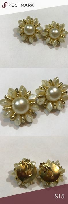 Pearl and Gold Clip Ons Earrings are Clip Ons. Has pearl in the middle with leafs around it to make a flower. Very cute, vintage , and classy. Please remember that these are vintage costume. I am not sure if Gold &  Pearls are authentic. Vintage Jewelry Earrings