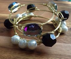 The Tredayy Stacklette  by FancyStacks on Etsy, $38.50. A set of 3 wire wrapped bangles. Available in Gold, Rose Gold or Silver. Standard and Custom Sizes available. The perfect, unique gift for bridesmaids, maid of honor, mothers day, birthdays and any special occasion.