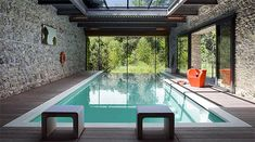 The popularity of indoor pools is partly due to their extreme versatility. People can swim in indoor pools at any point during the year, regardless of the Indoor Pools, Pools Inground, Light Steel Framing, Houses In Poland, Glass House Design, Interior Design Examples, Design Ideas, Design Inspiration, Decoration Inspiration