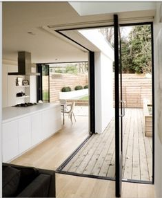 Love the different wooden flooring to differentiate between the inside and outside, but still allowing the doors to increase the space #bifolds