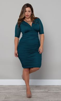 You'll definitely s(teal) the spotlight in this gorgeous curve hugging dress.  The Plus Size Betsey Ruched Dress by Kiyonna is aptly named Temptress Teal.  With such a beautifully saturated hue, we love it paired with a nude pump and bold (yet understated) jewelry.  #plussize #kiyonna