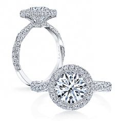 PIROUETTE is a handcrafted Jean Dousset Diamonds engagement ring - JeanDousset.com - shown in Platinum with a Round Brilliant cut diamond inside a seamless halo.