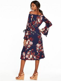 V by Very Bardot Midi Dress The bohotrend is in full swing, and what better way to embrace your inner hippie than with this floral Bardot midi from V by Very. Sitting prettily off the shoulder with this season's need-now fluted sleeves, this 70s-inspired frock is full of folksy appeal with a swishy silhouette, dark blooms and tie-up detail to the cuffs. We love. Styling Ideas Pair with tan-coloured wedges and a fedora for a throwback look.