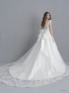Disney Wedding Dresses 2020 - a beautiful collection of Disney Wedding Dresses and gowns from the Fairytale Wedding Collection. Browse these 16 Disney Wedding Dresses and Gowns inspired by the Disney Princesses Belle, Tiana, Snow White, Cinderella and Tiana. Disney Wedding Dresses, Cinderella Dresses, Princess Wedding Dresses, Gown Wedding, Rapunzel Wedding Dress, Dream Wedding, Disney Weddings, Modest Wedding, Disney Inspired Wedding