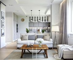 This small apartment has some great design features- brick walls, a white palette, amazing accessories....