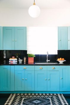 How to Add a Pop of Color for Less Than $100: Brilliant Blue Cabinets in Contemporary Kitchen >> http://www.diynetwork.com/made-and-remade/learn-it/ways-to-add-a-pop-of-color-for-under--100?soc=pinterest
