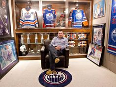 Shawn Chaulk poses with his collection of Wayne Gretzky memorabilia in Fort McMurray, Alta.