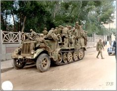 Deutsches Afrika Korps (DAK) German prisoners in a Luftwaffe Sd.Kfz.7 Krauss-Maffei Half Track (WL-35239) having surrendered to the British 7th Armoured Division in Tunis. May 1943.