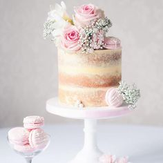 Pretty in pink vintage themed semi-naked birthday cake... adorned with fresh florals, large sugar pearls and our Strawberry Milkshake macarons!
