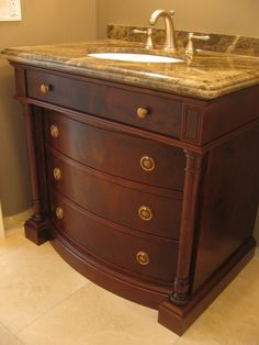 Custom curved drawer fronts were made in book matched walnut veneer. Custom turned details frame the drawer fronts and allow the piece to have that free standing look. This design was based on an antique dresser we saw.