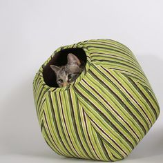 Give your cat a luxurious place to lounge with the Cat Ball. These stylish nooks are the perfect place for your cat to play, hide, or sleep. Made of cat-friendly materials and machine-washable, your cat will love them for their comfort. Available in this playful shark design, as well as many stylish patterns and colours perfect for any home decor.