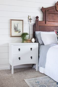 How to build a farmhouse style night stand with two drawers. This night stand has vintage charm with long legs, an arched apron, and drop-pulls.
