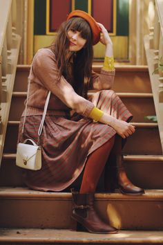 I thought this was Zooey deschanel... Well, whoever it is.. I love her outfit!