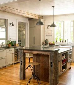 Large kitchen with great exposed beams. Love the rustic island very on trend. Kitchen lighting above the island really sets the kitchen off.  #kitchen #island #kitchenisland #breakfastbar #home #inspiration #largekitchen #rustic  Image source: www.shudah.co.uk