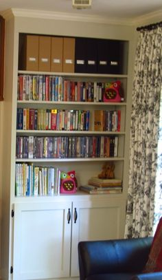 built in bookcase and toile curtains