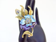 Blue and purple enamel and rhinestone brooch. Gold plated coloured enamels and rhinestones. 1940s by SellTheOld on Etsy #selltheold #trcteam #vtpassion #ecochic #brooch #floral brooch #flower