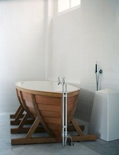 Is it a rowboat? Yes! Is it a bathtub? Yes!  It's both!    Designer, Wieki Somers, designed this limited edition bathtub out beautiful oak and red cedar.  Somers is considered part of the second generation of Dutch designers who have gained international acclaim in recent history.   Wieki  and partner