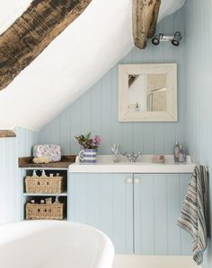 Looking for country bathroom ideas? Take a look at this tongue-and-groove vanity unit painted soft blue for inspiration. Find more bathroom ideas at theroomedit.com